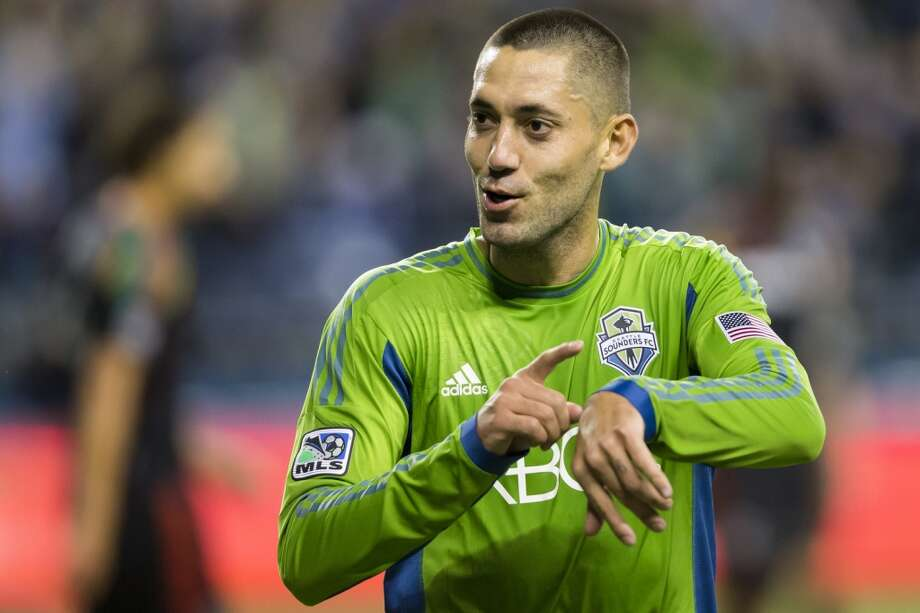 """Clint Dempsey mouths """"it's about time"""" while tapping at a metaphorical watch after making his first goal as a Sounders FC player during the first half of a game Sunday, Oct. 27, 2013, in Seattle. The Sounders led the Galaxy 1-0 at the half but ended in a 1-1 tie. (Jordan Stead, seattlepi.com) Photo: JORDAN STEAD, SEATTLEPI.COM"""