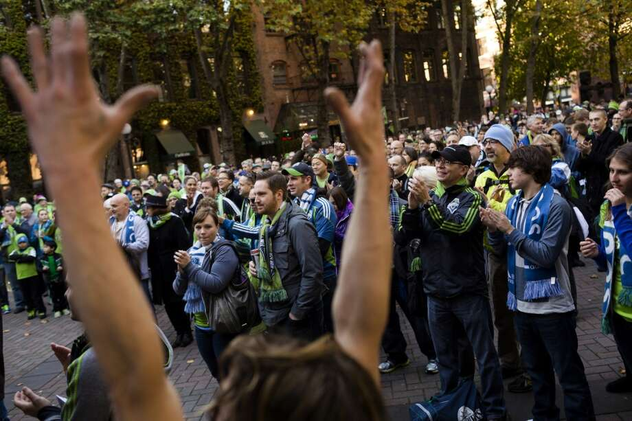 Hundreds of fans gather for a show by The Helio Sequence before the final Sounders game of the regular season against the LA Galaxy Sunday at Occidental Park in Seattle.  (Jordan Stead, seattlepi.com) Photo: JORDAN STEAD, SEATTLEPI.COM
