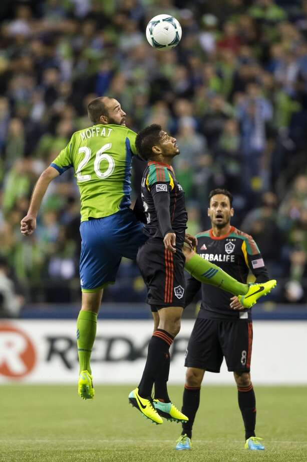 Adam Moffat, left, collides with an LA Galaxy player in midair while competing for a header during the first half Sunday. (Jordan Stead, seattlepi.com) Photo: JORDAN STEAD, SEATTLEPI.COM