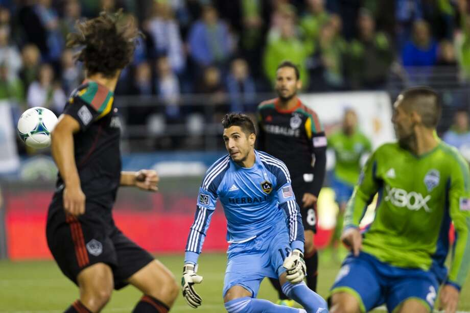 Clint Dempsey, right, scores his first goal as a Sounders FC player during the first half of Sunday The game ended in a 1-1 tie. (Jordan Stead, seattlepi.com) Photo: JORDAN STEAD, SEATTLEPI.COM