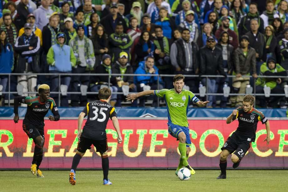 Brad Evans, center right, dribbles through LA Galaxy defense during the first half Sunday. (Jordan Stead, seattlepi.com) Photo: JORDAN STEAD, SEATTLEPI.COM