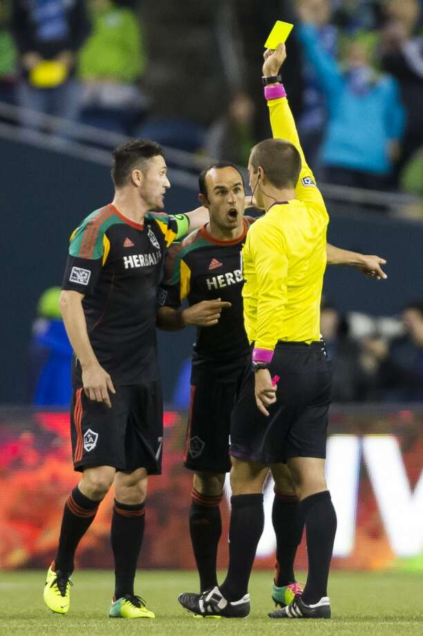 LA Galaxy players react to a ref's yellow card during the first half of Sunday. (Jordan Stead, seattlepi.com) Photo: JORDAN STEAD, SEATTLEPI.COM