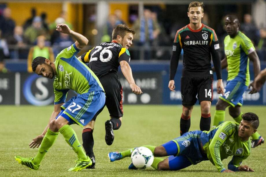Lamar Neagle, left, and DeAndre Yedlin, bottom right, scramble for a loose ball.  (Jordan Stead, seattlepi.com) Photo: JORDAN STEAD, SEATTLEPI.COM