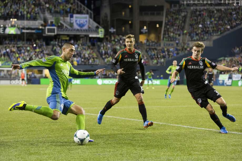 Clint Dempsey, left, attempts a shot on LA Galaxy goal from outside of the box. (Jordan Stead, seattlepi.com) Photo: JORDAN STEAD, SEATTLEPI.COM