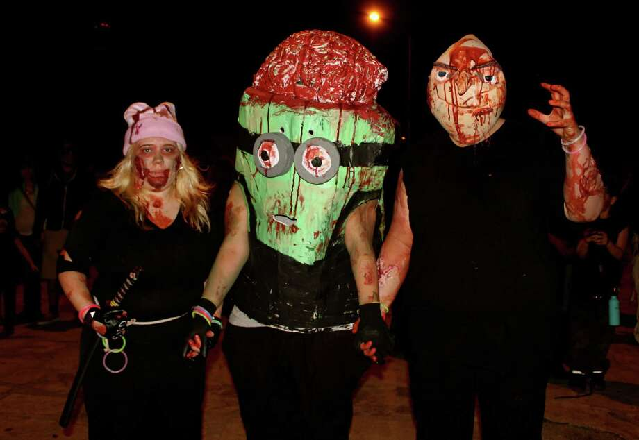 Locals roam the streets of San Antonio as the living dead. Photo: Yvonne Zamora, For MySA.com