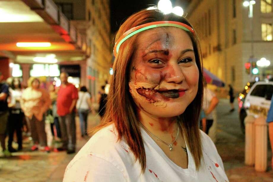 Locals roam the streets of San Antonio as the living dead. Photo: Yvonne Zamora, For MySA.com