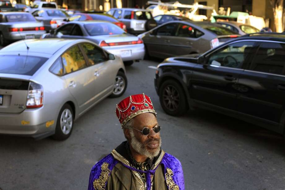 King Kobbler watches for his next customer as commuters  pile up near the entrance of the Bay Bridge during a BART Strike in San Francisco, Calif. Photo: Mike Kepka, The Chronicle