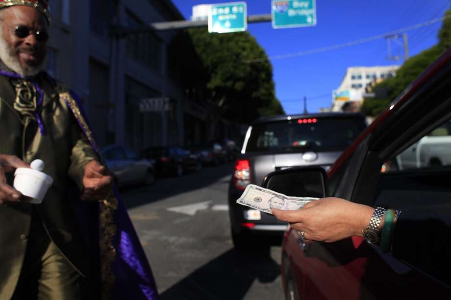 King Kobbler comes through with a carton of peach cobbler for a customer holding a crisp 5 dollar bill in San Francisco, Calif. Photo: Mike Kepka, The Chronicle