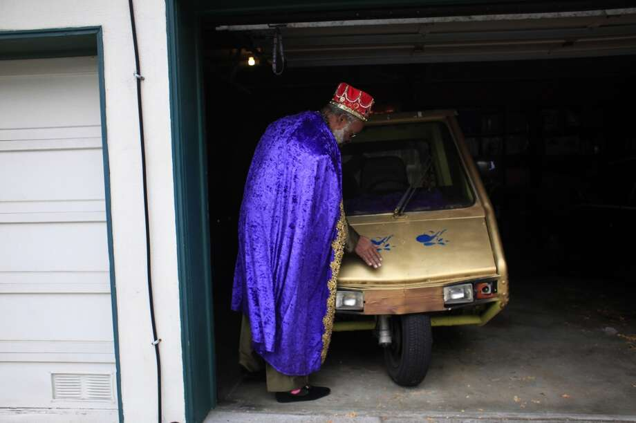 King Kobbler brushes a touch of dust of his golden Cushman parked in his San Francisco garage. Photo: Mike Kepka, The Chronicle