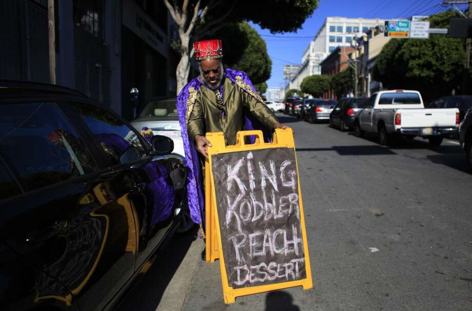 King Kobbler fine tunes his sign placement in front of a captive commuter audience trying to get on the Bay Bridge during a BART Strike in San Francisco, Calif. Photo: Mike Kepka, The Chronicle