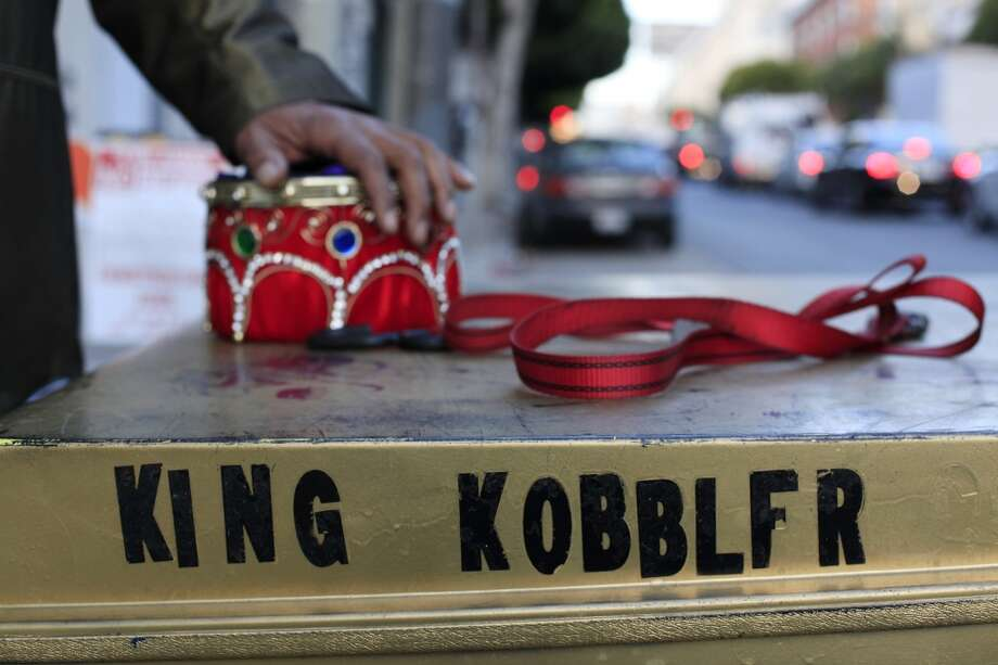 Done for the day, King Kobbler takes off his crown before heading home in San Francisco, Calif. Photo: Mike Kepka, The Chronicle