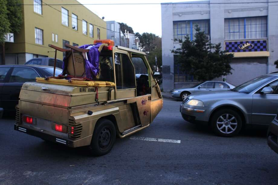 On his way home, King Kobbler squeezes his golden Cushman through traffic in San Francisco, Calif. Photo: Mike Kepka, The Chronicle