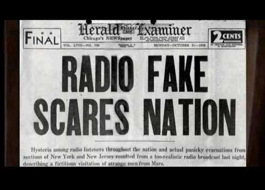 "The front page of the Chicago Herald Examiner on Oct. 31, 1938 after Orson Welles' radio broadcast of H.G. Welles ""War of the Worlds"" scared some Americans into believing aliens were invading the country."