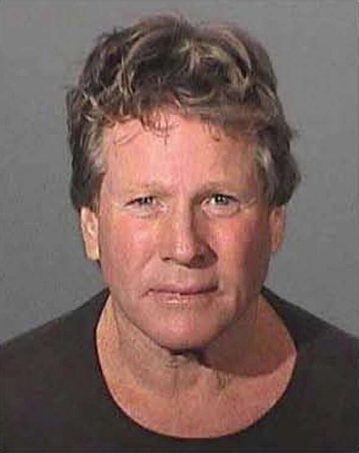 Actor Ryan O'Neal is shown in this booking mug taken and released to Reuters February 4, 2007. O'Neal was arrested and accused of assaulting his grown son with a handgun during a fight in the actor's Malibu home, the Los Angeles County Sheriff's Department said on Sunday. Photo: HO, REUTERS