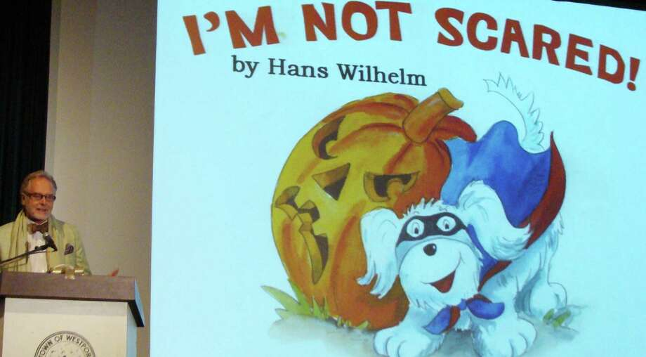 "Prolific childrenís book author and illustrator Hans Wilhelm of Weston, a Westport Arts Award recipient, read to the audience at Sunday's Westport Arts Awards ceremony from his book ""I'm Not Scared."" Photo: Meg Barone / Westport News contributed"