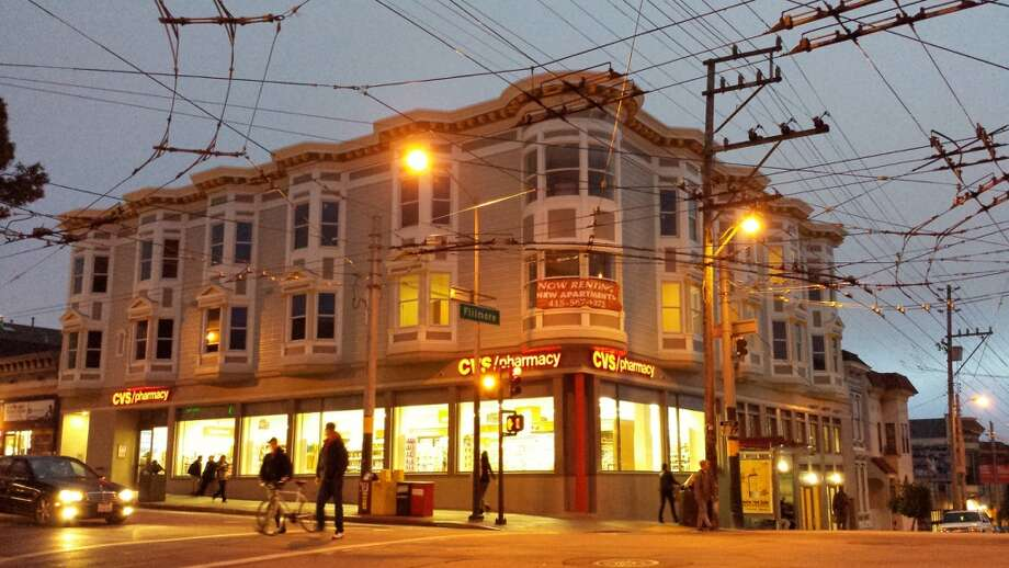 Have closely watched the recovery of the building at Haight and Fillmore, gutted by a fire two years ago (plus, you're ready to start chowing on Three Twins again). Photo: Douglas Zimmerman, SFGate