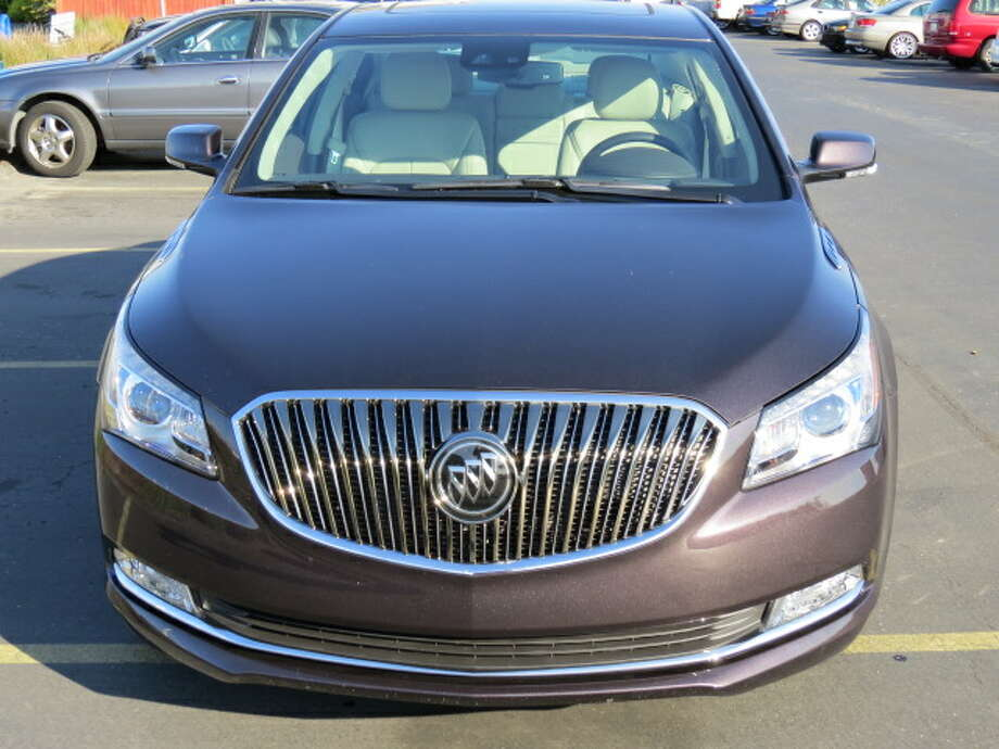 The car does have Buick-familiar style elements – the waterfall grille, the front-fender portholes (or simulated portholes), the pretty conservative overall shape and lines – and it feels, inside, like most cars of this price range.