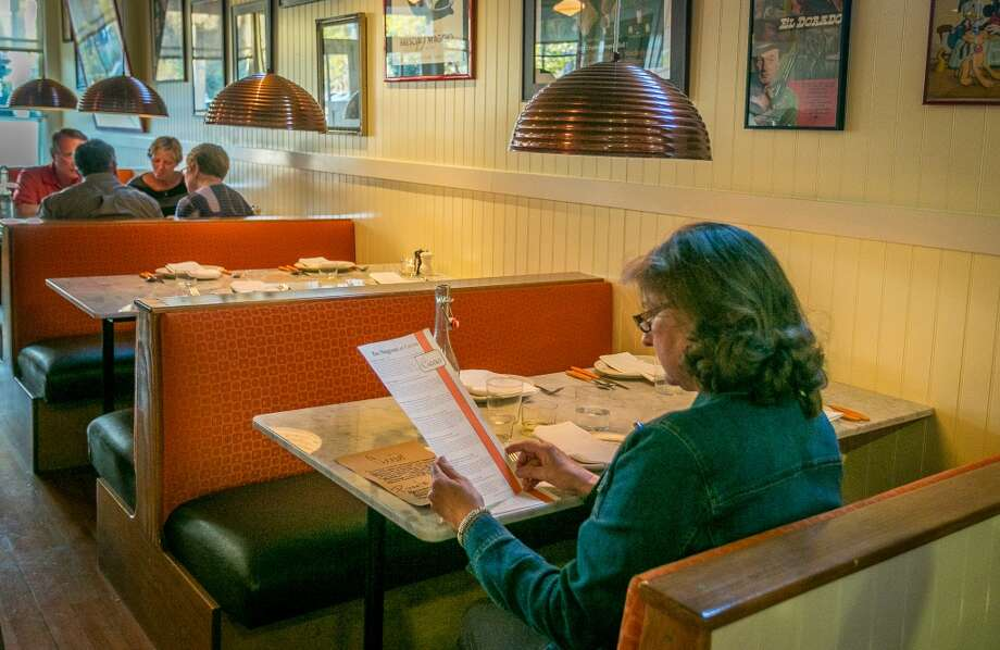 A woman reads the menu at Ciccio Photo: John Storey, Special To The Chronicle