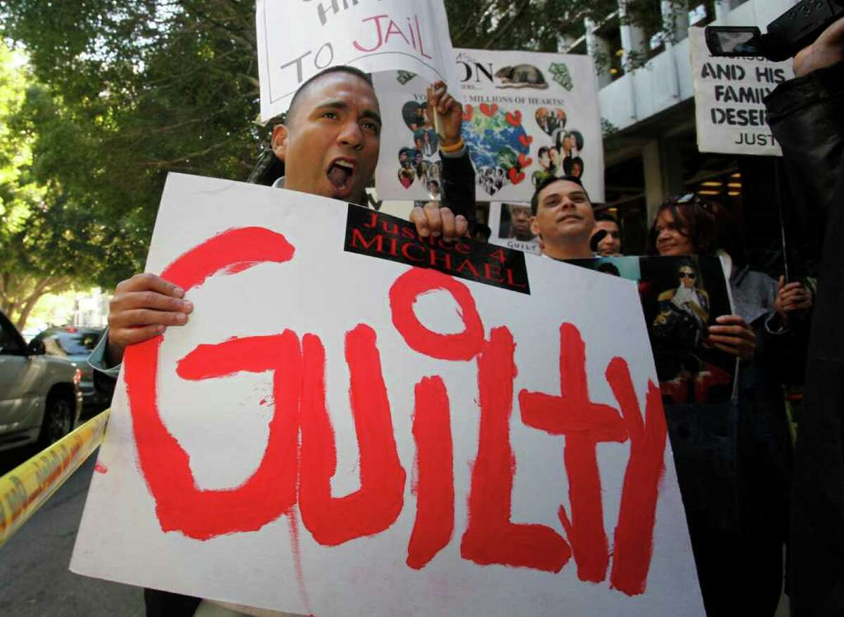 Michael Jackson supporter, Anthony Solis, screams for justice while holding a guilty sign on the sidewalk outside of the Clara Shortridge Foltz Criminal Justice Center, Monday, November 7, 2011, where jurors are deliberating the involuntary manslaughter charges against Dr. Conrad Murray.