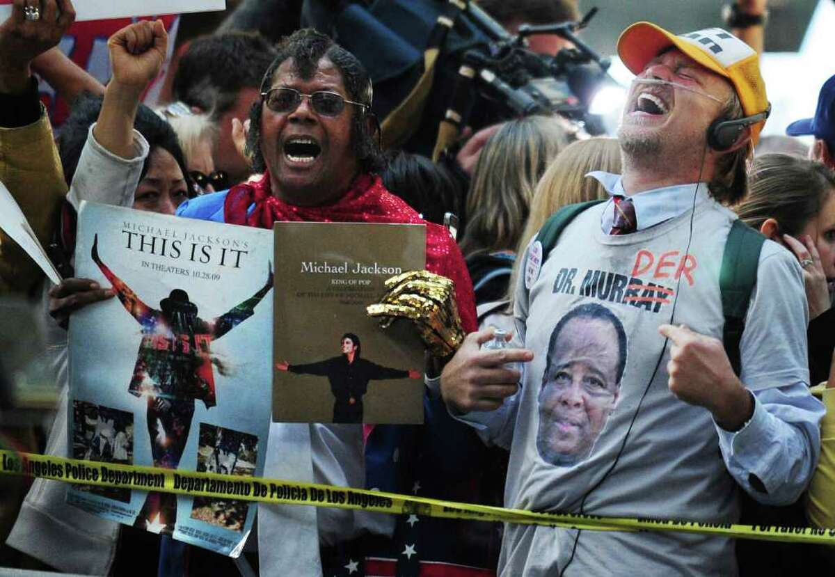 Supporters of Michael Jackson holding placards outside the courthouse react to the announcement of the verdict of his doctor's trial in Los Angeles on November 7, 2011 in southern California. Michael Jackson's doctor Conrad Murray was found guilty of involuntary manslaughter over the King of Pop's 2009 death, the court clerk said. There was a brief cry in the courtroom, and cheers outside, but Murray himself gave no reaction when the long-awaited verdict was announced after a six-week trial in Los Angeles.