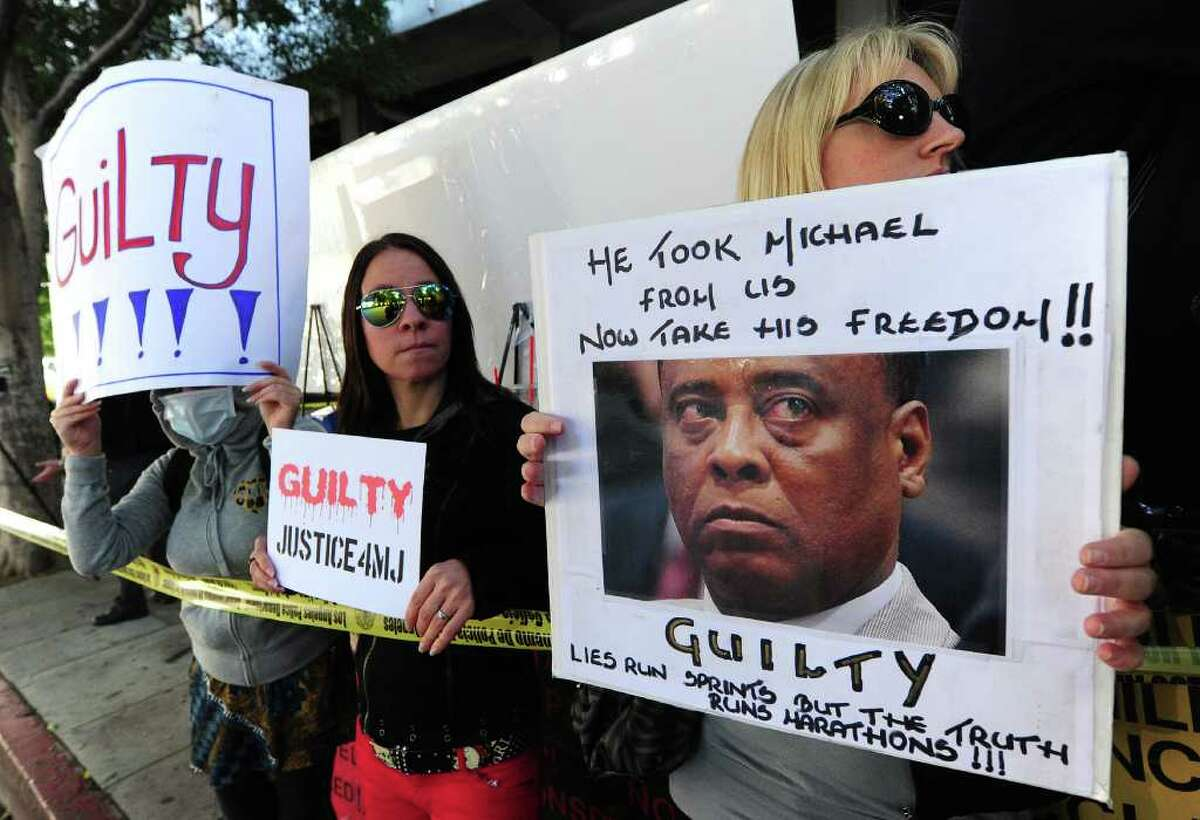 Supporters of Michael Jackson hold placards awaiting the verdict of his doctor's trial in Los Angeles on November 7, 2011 in southern California. Michael Jackson's doctor Conrad Murray was found guilty of involuntary manslaughter over the King of Pop's 2009 death, the court clerk said. There was a brief cry in the courtroom, and cheers outside, but Murray himself gave no reaction when the long-awaited verdict was announced after a six-week trial in Los Angeles.