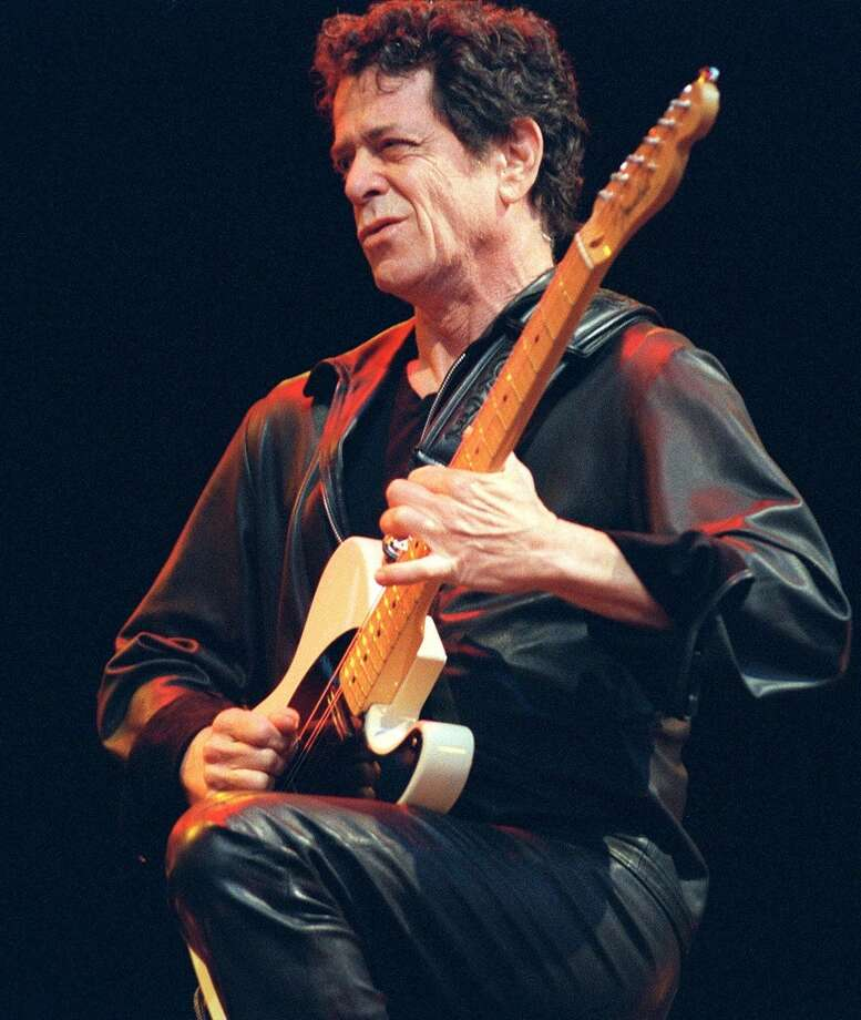 """** ADVANCE FOR WEEKEND, FEB 1-2 ** U.S. singer and guitarist Lou Reed, the veteran of the New York underground movement and founder of the Velvet Underground some 30 years ago, performs on stage at the open air 'Live at Sunset' in Zurich, Switzerland July 30, 2000. Reed's new album """"The Raven"""" was released by Sire-Reprise records. (AP PHOTO/KEYSTONE/Monika Zaugg) Photo: AP"""