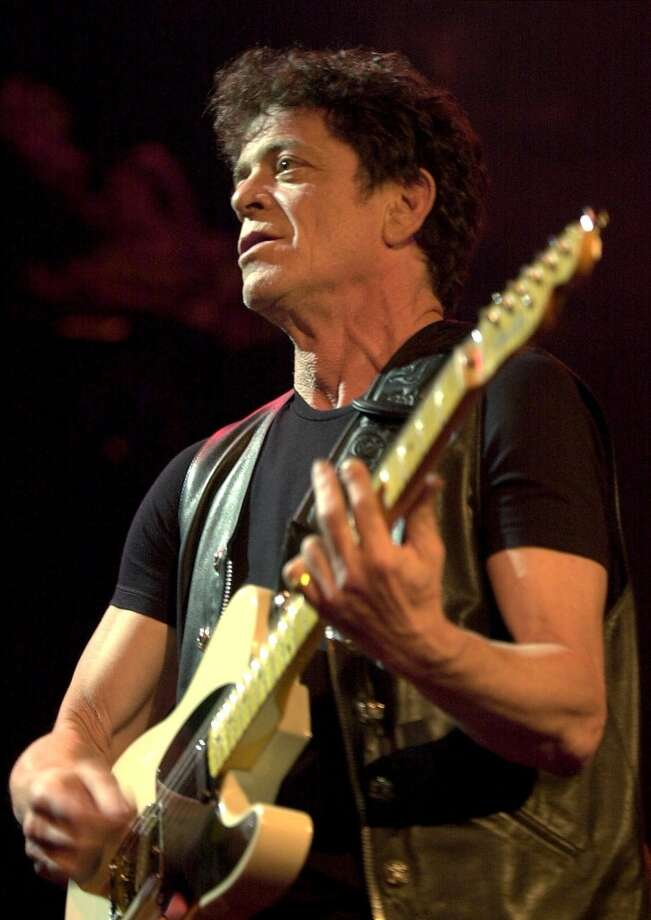 FILE--Singer Lou Reed performs on stage at the 34th Montreux Jazz Festival in Montreux, Switzerland, in this Thursday, July 13, 2000 file photo.   On Tuesday, in collaboration with avant-garde theater director Robert Wilson, Reed, 59, will usher in a new song cycle based on Edgar Allen Poe's works. He has written the book, music and 13 songs for 'POEtry,' which runs through Dec. 8 at the Brooklyn Academy of Music. (AP PHOTO/KEYSTONE/Martial Trezzini, File) Photo: AP