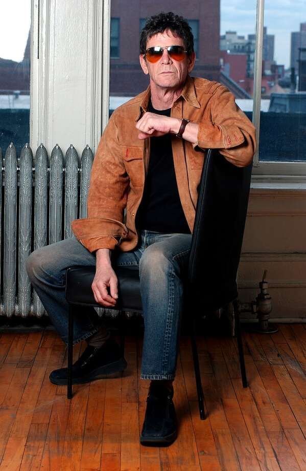 "** ADVANCE FOR WEEKEND EDITIONS, JUNE 5-8 **Singer and songwriter Lou Reed sits for a portrait in New York, April 23, 2003. In early June, Reed, 61, released a new album, ""NYC Man_The Ultimate Lou Reed Collection,"" a 31-track retrospective that spans his Velvet Underground and solo years. (AP Photo/Gino Domenico) Photo: AP"