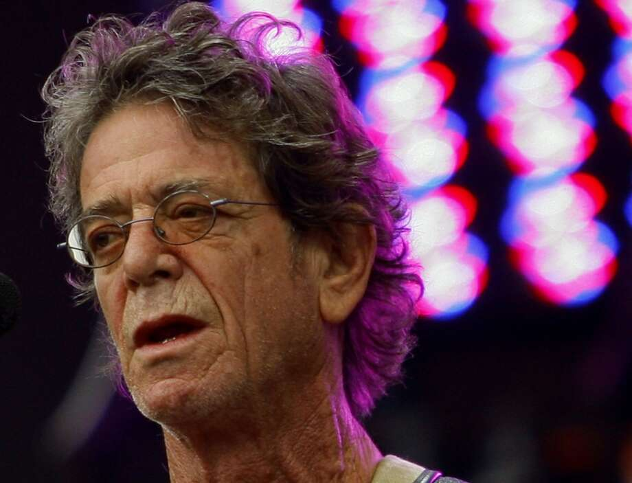 """FILE- In this Sunday, Aug. 9, 2009 file photo, Lou Reed performs at the Lollapalooza music festival, in Chicago. Lou Reed's wife says the rock icon is recovering after a life-saving liver transplant, according to an interview published Saturday, June 1, 2013,  in a British newspaper. Laurie Anderson told the Times of London that Reed """"was dying"""" before the operation in April at Ohio's Cleveland Clinic. (AP Photo/John Smierciak, File) Photo: AP"""