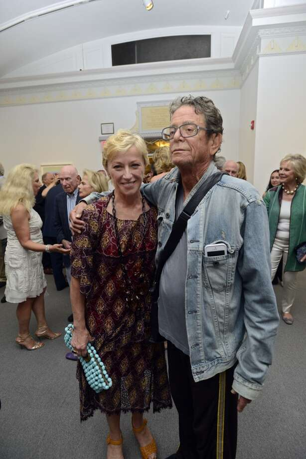 Cindy Sherman and Lou Reed, both subjects of Chuck Close portraits, at a special preview of portraits by Chuck Close in East Hampton, N.Y., Aug. 9, 2013. A special preview of Chuck Close portraits were exhibited at Guild Hall Center for the Visual and Performing Arts, followed by the Hall's annual summer gala, in a tent on the estate of Leonard and Louise Riggio. (Doug Kuntz/The New York Times) ORG XMIT: XNYT87 Photo: New York Times