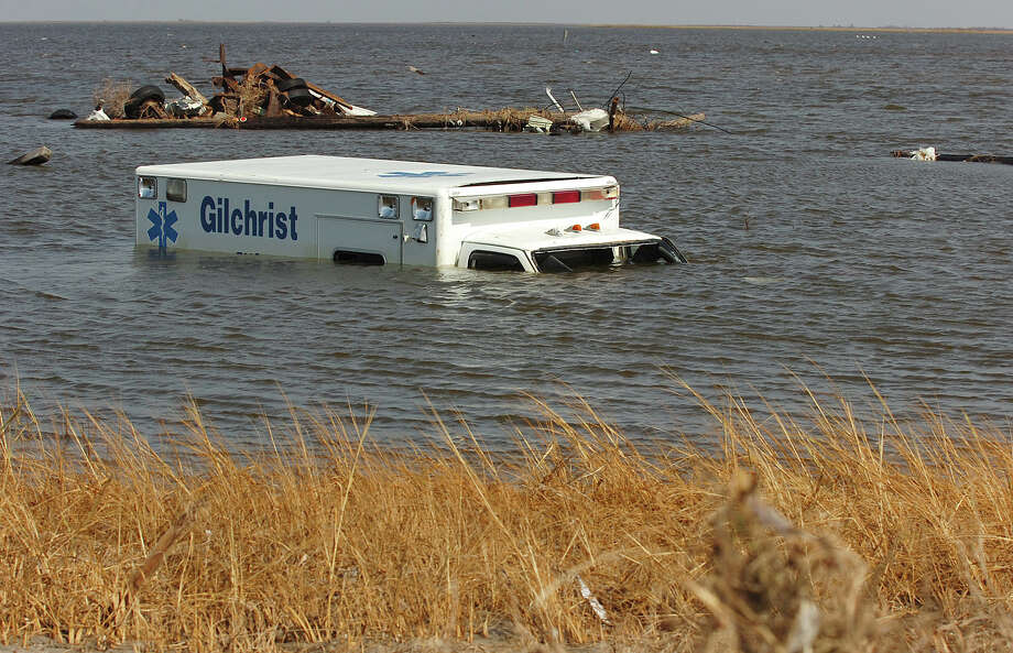 A Gilchrist ambulance rests in the bay on Bolivar Peninsula. Wednesday, September 24, 2008 Guiseppe Barranco/The Enterprise