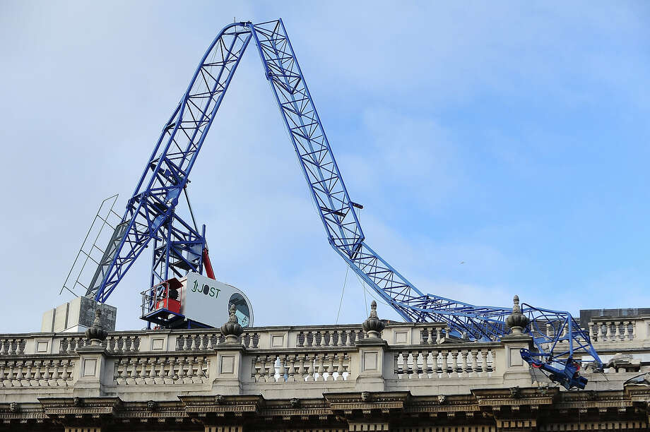 A crane which collapsed during the storm lies on the Cabinet Office roof on October 28, 2013 in London, United Kingdom.  Overnight the St Jude storm swept through Britain, causing floods, power cuts and major transport cancellations. Photo: Scott Campbell, Getty Images / 2013 Scott Campbell