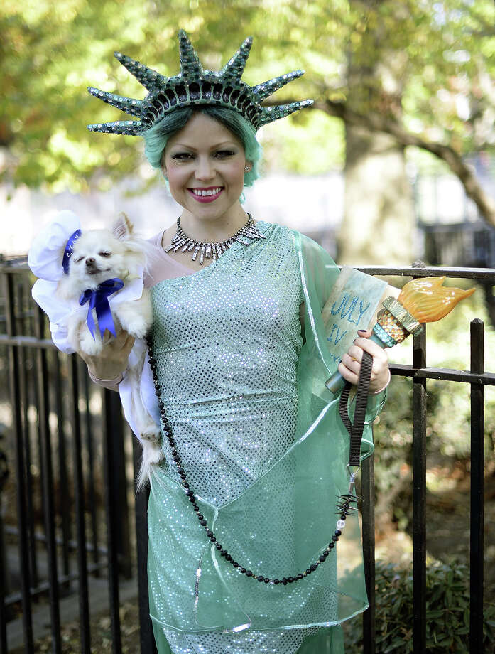 Summer Strand and her dog participate in the 23rd Annual Tompkins Square Halloween Dog Parade on October 26, 2013 in New York City. Thousands of spectators gather in Tompkins Square Park to watch hundreds of masquerading dogs in the country's largest Halloween Dog Parade. Photo: TIMOTHY CLARY, AFP/Getty Images / 2013 AFP