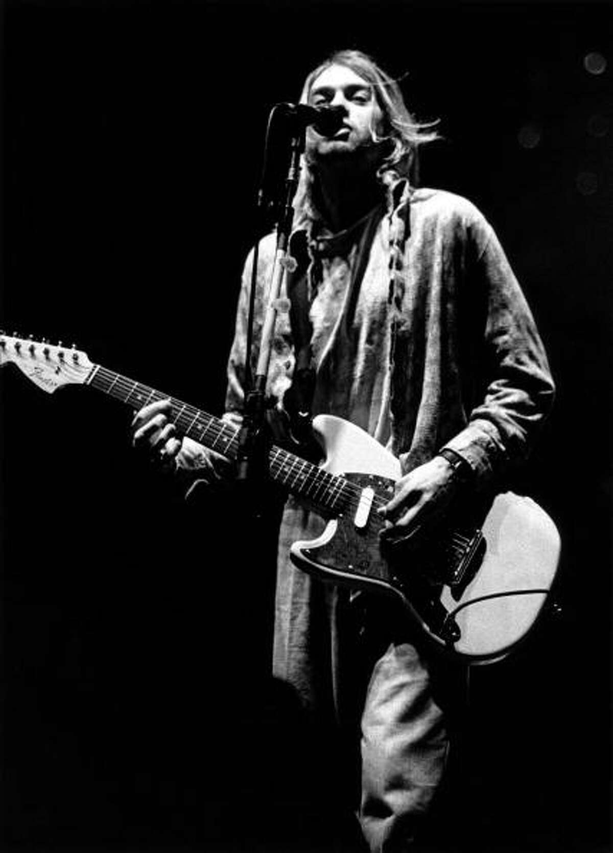 ITALY - FEBRUARY 21: Photo of Kurt COBAIN and NIRVANA; Kurt Cobain performing live onstage at Palasport, Modena, playing Fender Mustang guitar