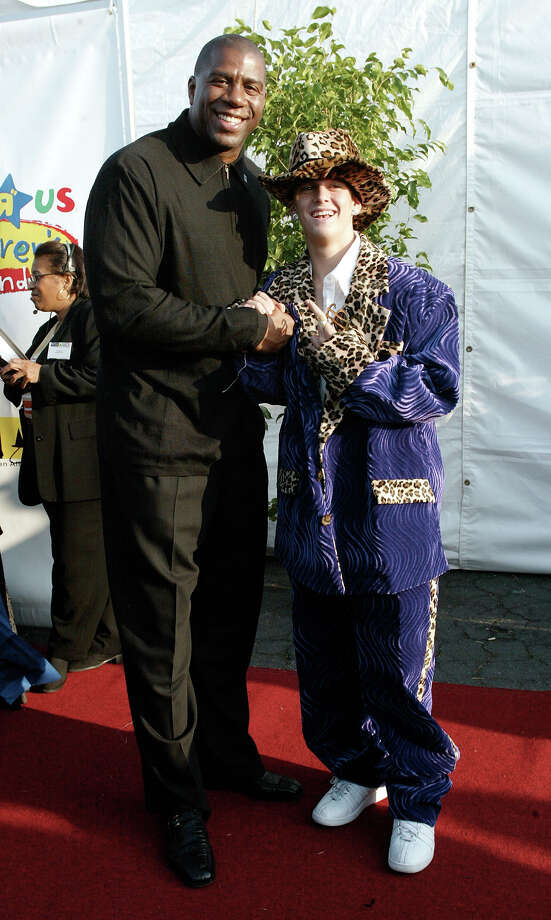 "Former Los Angeles Laker basketball player Ervin ""Magic"" Johnson (L) and actor Aaron Carter attend the 9th Annual Dream Halloween Los Angeles benefit  on October 26, 2002 in Santa Monica, California.  The fund raising event benefits children across the United States that have HIV symptons and AIDS. Photo: Frederick M. Brown, Getty Images / 2002 Getty Images"