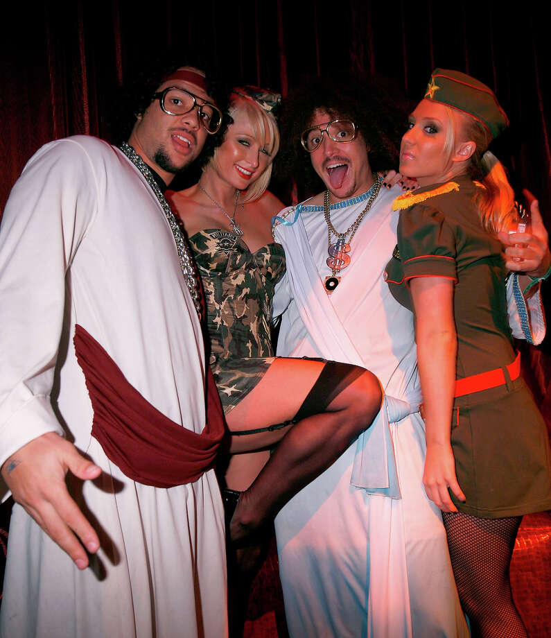 "Paris Hilton (center left) with SkyBlu and RedFoo of band LMFAO and manager Brooke Ashley attend ""A Very Sexy Halloween"" at LAX Nightclub on October 31, 2007 in Las Vegas, Nevada. Photo: Chris Weeks, WireImage / WireImage"