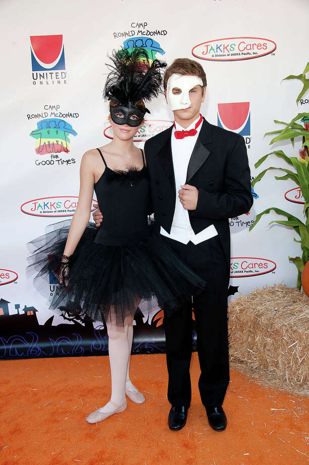 Actress Bella Thorne (L) and actor Garrett Backstrom arrive at Camp Ronald McDonald For Good Times' 19th Annual Halloween Carnival at Universal Studios on October 23, 2011 in Universal City, California. Photo: Amanda Edwards, Getty Images / 2011 Amanda Edwards