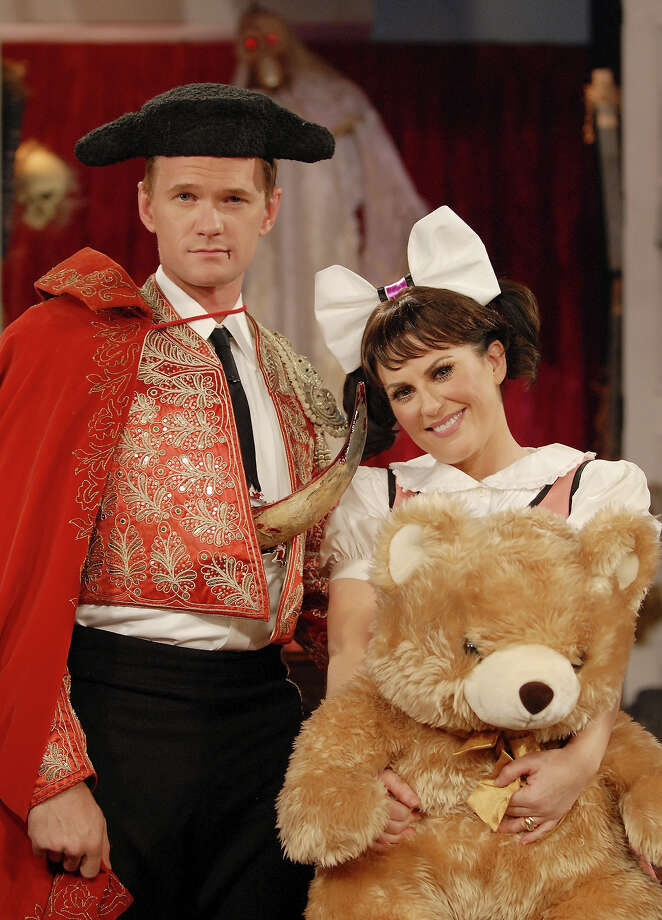 Actor Neil Patrick Harris dressed in costume and host Megan Mullally dressed in costume as Edith Ann pose on October 31, 2006. Photo: NBC, NBC Via Getty Images / © NBC Universal, Inc.