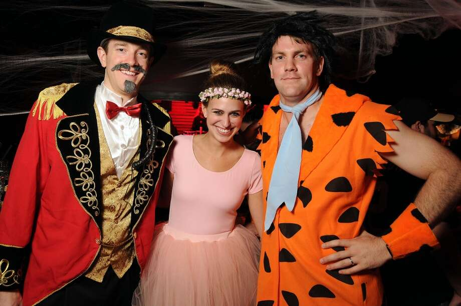 Max Barrett, Lauren Baughman and Robert Urquhart at the Saints and Sinners party Photo: Dave Rossman, For The Houston Chronicle