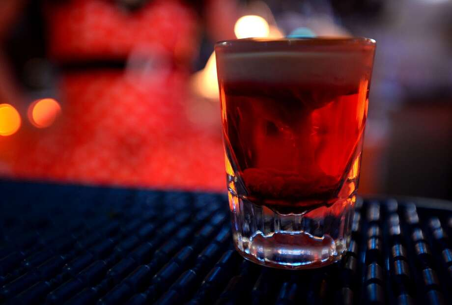 A Bloody Brains shot at King Arthur's Pub in Beaumont. The drink is made with strawberry liquor, Irish cream and grenadine.   Photo taken Monday, October 14, 2013 Guiseppe Barranco/The Enterprise