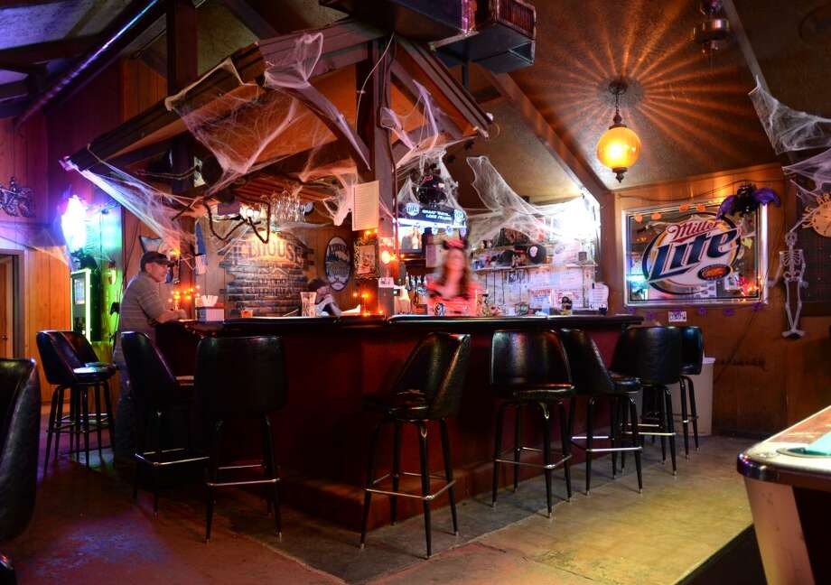 King Arthur's Pub in Beaumont is celebrating the scary season with decorations, costumes and a Halloween party. Photo taken Monday, October 14, 2013 Guiseppe Barranco/The Enterprise