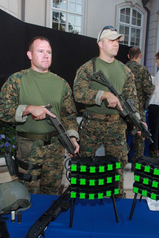 Allan Comstock, left, and Daryl Hudeck, of HPD SWAT, with a display of some of the equipment they use at the sixth annual True Blue gala benefiting the Houston Police  Foundation. Photo: Gary Fountain, For The Chronicle