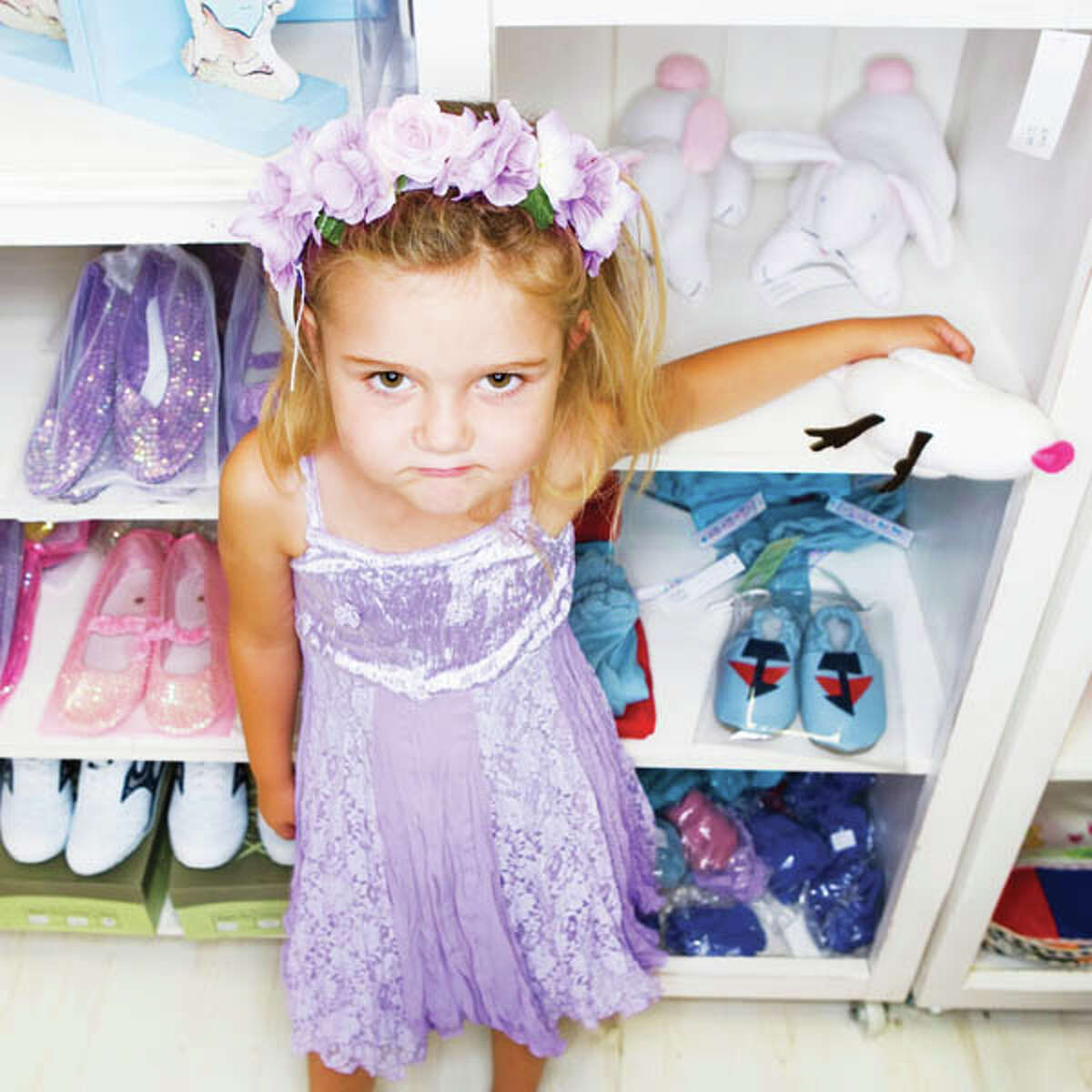 Dressed up Girl Standing at Shelf