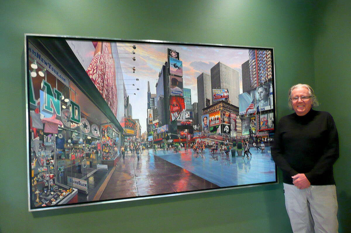 """Art collector Richard McKenzie stands by """"Time Square"""" by Robert Neffson."""