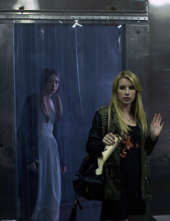 "Taissa Farmiga as Zoe, Emma Roberts as Madison in ""American Horror Story: Coven."" Photo: Michele K. Short, FX"