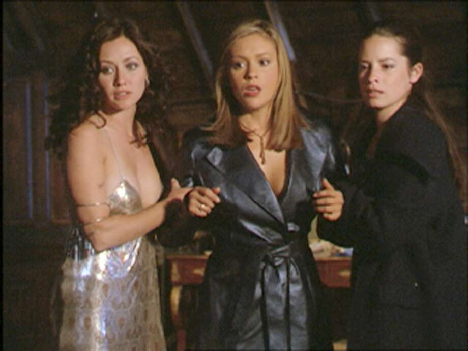"Prue (Shannen Doherty), Phoebe (Alyssa Milano) and Piper (Holly Marie Combs) of The WB's witch drama, ""Charmed,"" which ran from 1998-2006. Photo: THE WB, TLP"