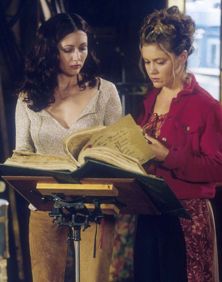 "Phoebe (Alyssa Milano) and Piper (Holly Marie Combs) are lured to the dark side on ""Charmed"" Photo: THE WB/BYRON COHEN, TLP"