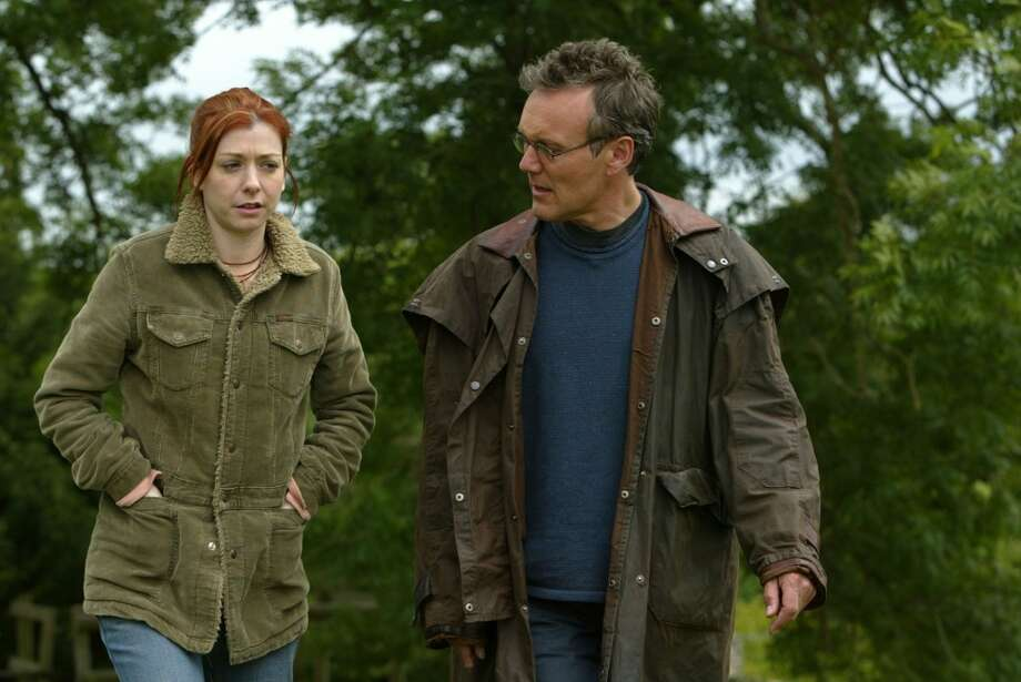 """A remorseful Willow (Alyson Hannigan) turns to Giles (Anthony Stewart Head)for guidance as she seeks to control the magical forces that consume her in """"Buffy the Vampire Slayer."""" Photo: JUSTIN CANNING, UPN"""