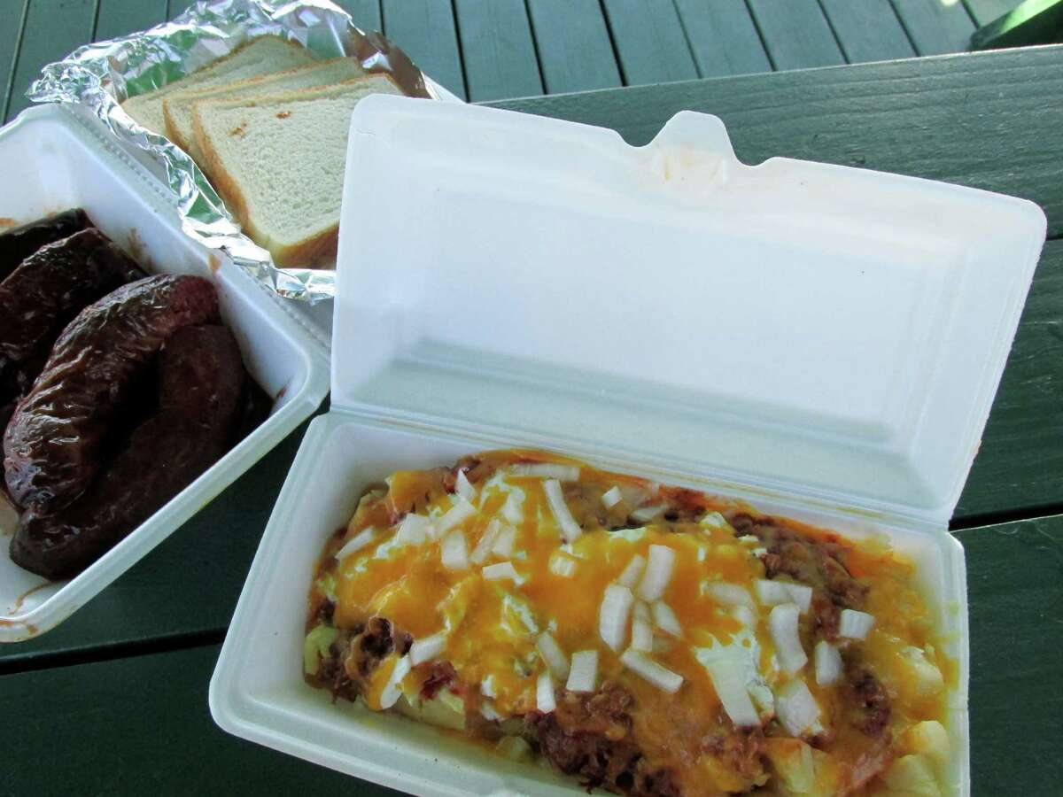 The loaded baked potato with onions at Broussard's Links Plus Ribs in Beaumont.