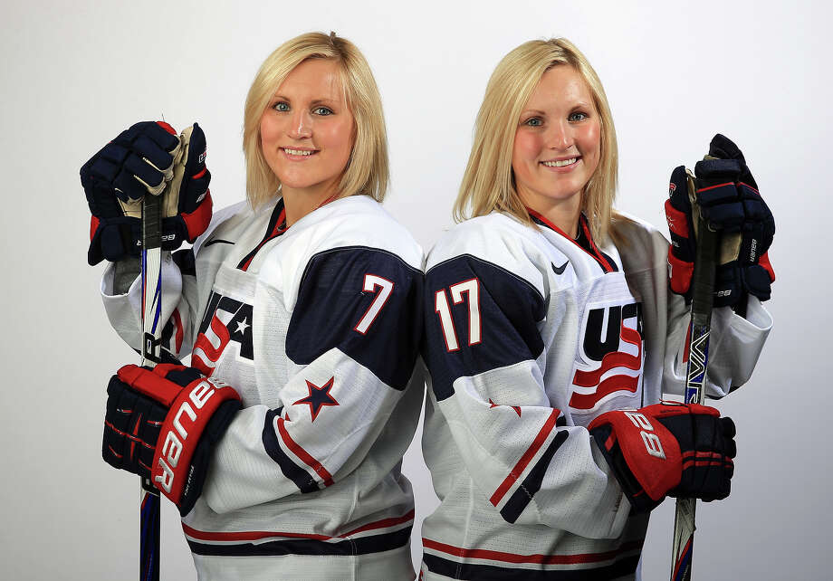 Ice hockey players Monique Lamoureux (L) and Jocelyne Lamoureux pose for a portrait during the USOC Media Summit ahead of the Sochi 2014 Winter Olympics on October 2, 2013 in Park City, Utah. Photo: Doug Pensinger, Getty Images / 2013 Getty Images